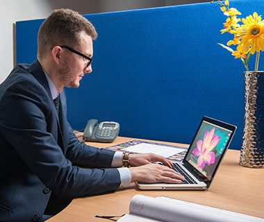 Image of man working at desk