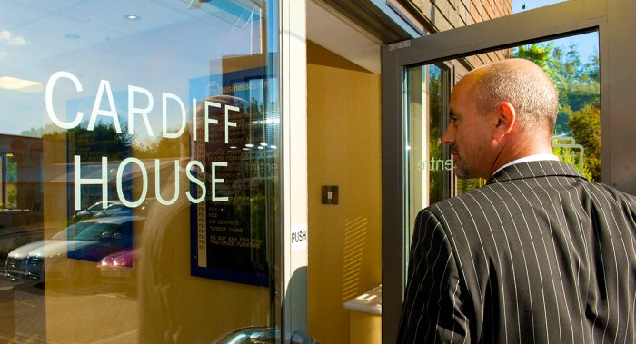 Image of man entering Cardiff House.